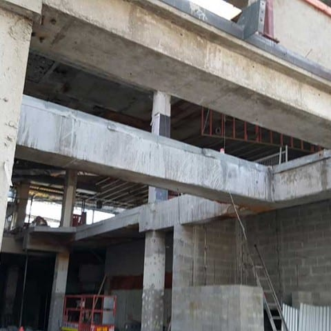 Suspend floors and concrete beams saw cut for removal