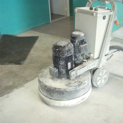 Grinding a floor in preparation for tiles