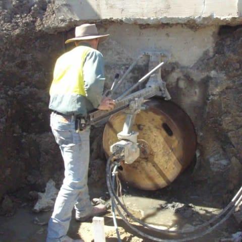 Core drilling a storm pit